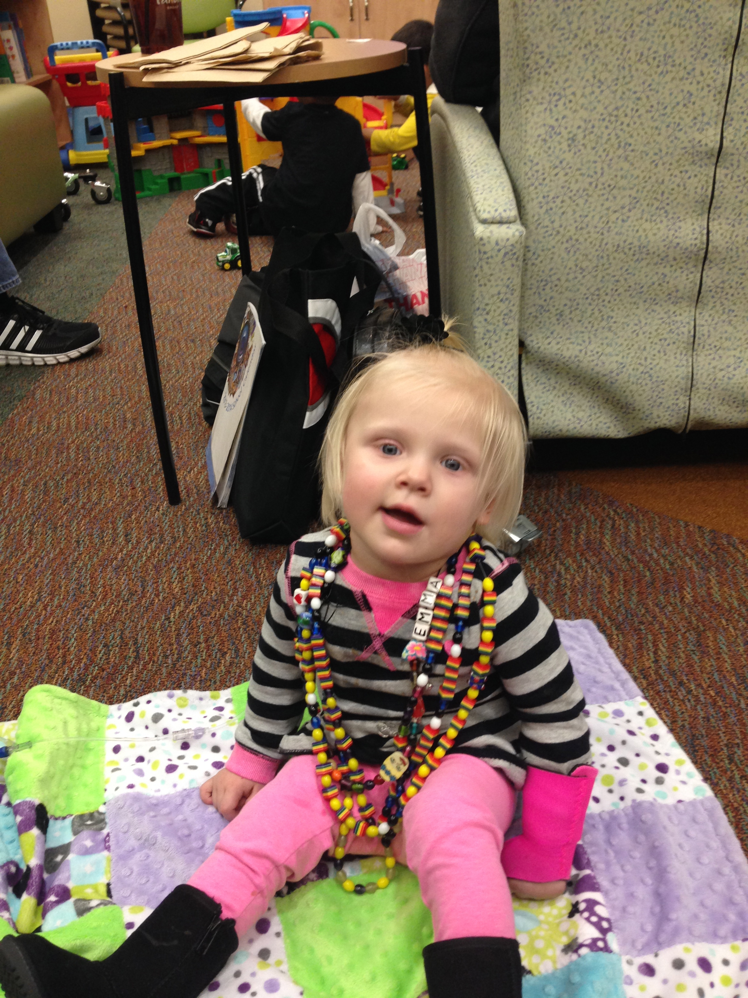 Emma with all of her Beads of Courage