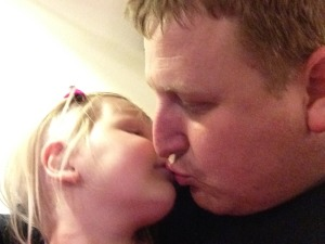 Daddy stealing some kisses at the doctors office.