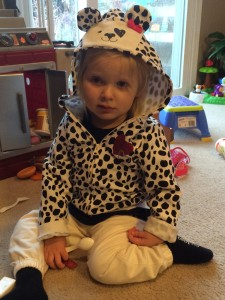 Emma in her new puppy jacket. She loves to scoot around and pant like a puppy:)