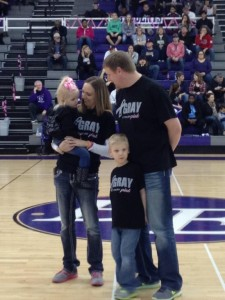 Emma being recognized at half time of the games.