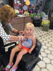 Emma getting her hair trimmed.