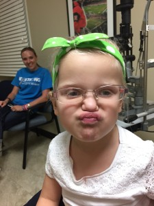 Silly girl making faces while we wait at the eye doctor.