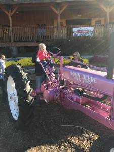 Had to sit on the Pink tractor again.