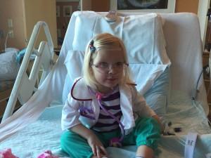 Emma dressed up as Doc McStuffins.