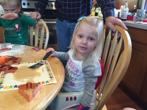 Emma now three years into this journey. She is having fun making Christmas cookies!