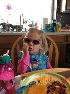 Emma's future with a possibility of no chemo is so bright she has to eat lunch with her Minnie glasses