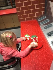 She is a big fan of making pizza at the Childrens museum as well.