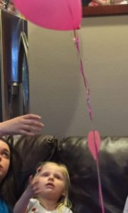 """Emma was so excited to get balloons and flowers from her loving Paras at school and even flowers from the neighbors celebrating her """"last"""" chemo."""