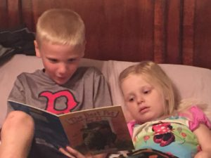 I can't tell you how much we all, especially Emma, miss this little man.  Here is a pic of Aiden reading to Emma on Monday before we left.